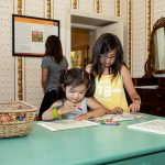 Aaliyah O'Brien (left) and Gwen O'Brien (right) at the coloring exhibit inside the Museum © The National Trust for Historic Preservation