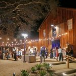 A nighttime reception at the Cooper Barns